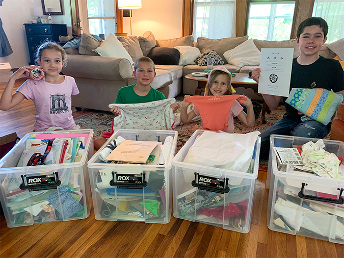 The O'Donnell kids with their memory boxes, from left: Harper, with an art project; Ezra, with his baby blanket; Ivy, with a school hat and newborn onesie; Jones, with a Japanese diploma and a quilt.